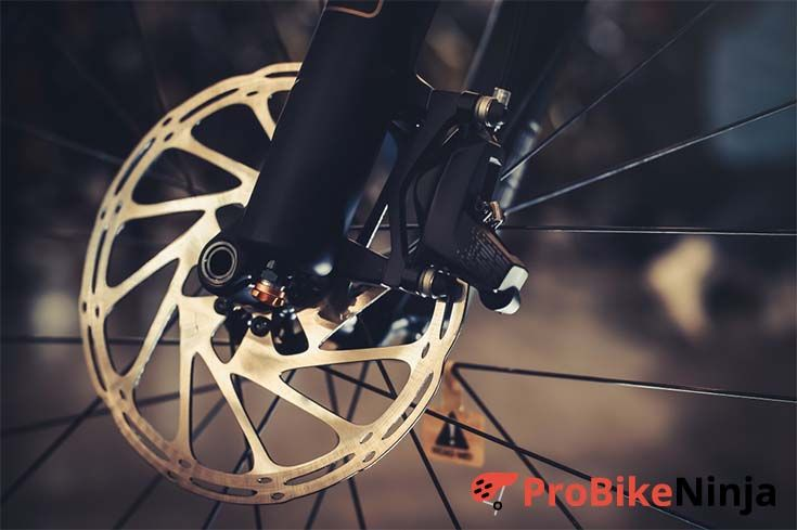 How do disc brakes work on a bike